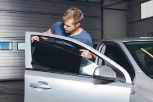 applying-tinting-foil-onto-a-car-window